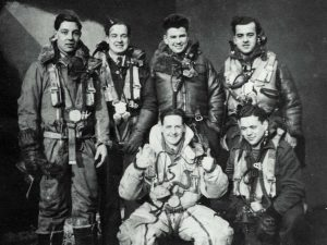 A Lancaster bomber had a crew of seven. Donald was the pilot and the Captain. His crew: (back row) Joe Taylor, gunner; Trevor Williams, flight engineer; Jean-Louis Viau, bomb-aimer; (in front) Jock Lochrie, rear gunner, who was not on the fatal flight on March 12, 1943; and Ralph Franks, wireless operator. The 7th person, John Smith, the navigator, presumably took the photo.